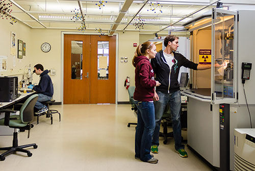Graduate students in the UW-Madison Department of Chemistry X-Ray Crystallography Facility, photo by Dr. Ilia Guzei