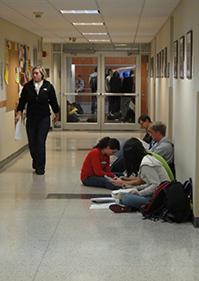 Lab groups working in hallway