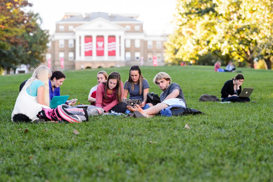 students study on Bascom Hill