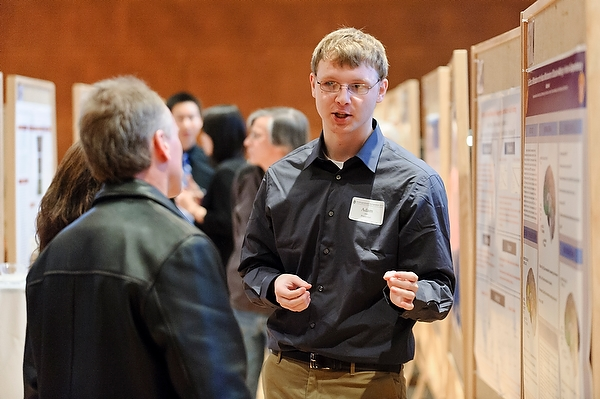 Adam Awe (right) presents his research project at the Undergraduate Research Symposium