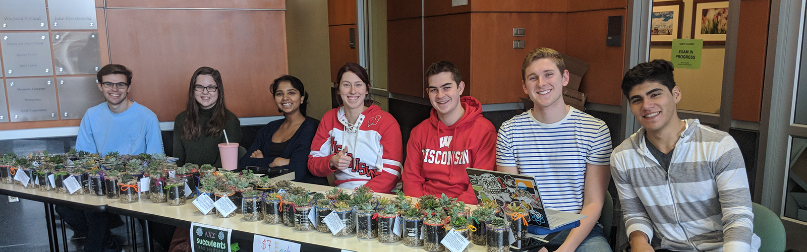 alpha chi sigma members with succulents for science