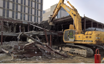 In December, the jaws on this and two other demolition machines tore away steel and concrete from the north side of Daniels.