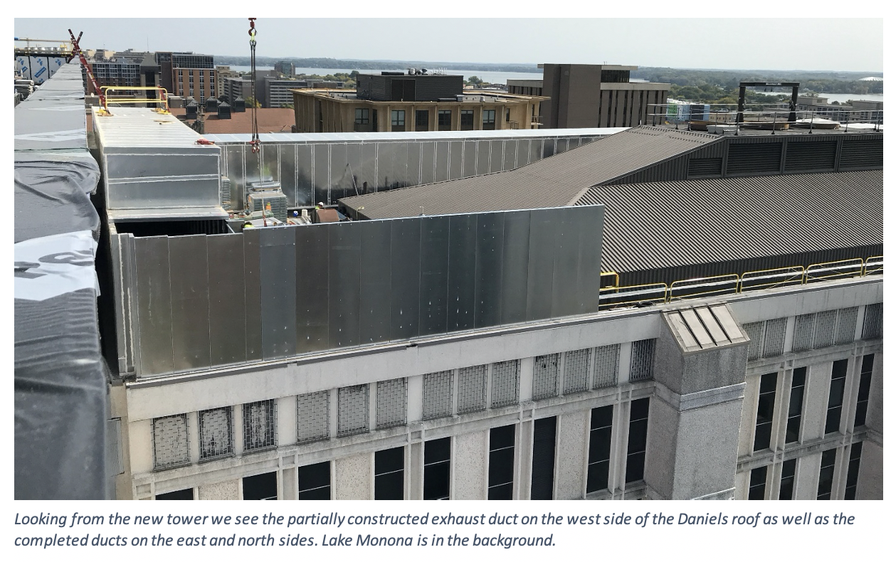 Looking from the new tower we see the partially constructed exhaust duct on the west side of the Daniels roof as well as the completed ducts on the east and north sides. Lake Monona is in the background.