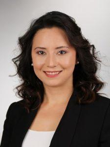 Professional headshot, brunette woman, facing foward, white shirt and black blazer