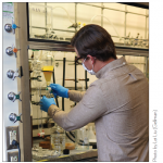 man works on experiment in fume hood