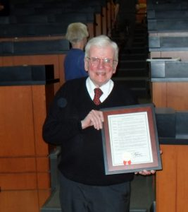 man with certificate