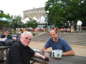 two men at an outdoor table
