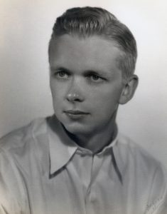black and white photo of a young man with head turned