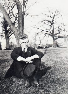 man sitting in the grass