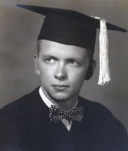 black and white photo of man in cap and gown