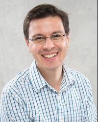 Man in glasses smiling