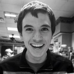 black and white photo of person smiling